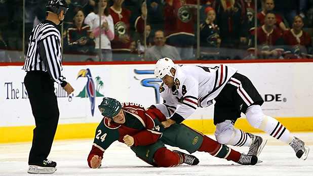 David Koci #48 of the Chicago Blackhawks fights with Derek Boogaard #24 of the Minnesota Wild in a preseason game September 30, 2007 at the Xcel Energy Center in St. Paul, Minnesota.