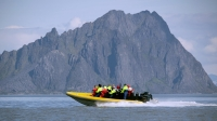 A RIB boating blasts around the Lofoten Islands.