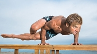You don't need an hourlong class or superhuman flexibility (like what Laird Hamilton shows off here) to start the day off right.