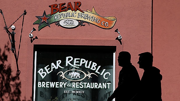 Pedestrians walk by the Bear Republic Brewery in Healdsburg, California. Sonoma County breweries Lagunitas and Bear Republic rely on water from the Russian River and are worried that the low water levels will force them to seek water from other sources.