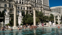 Guests enjoy the pool at Caesars Palace and Casino.