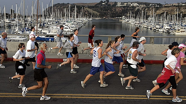 Runners have a scenic view of Dana Point Harbor during the 10K Dana Point Turkey Trot early Thanksgiving morning.