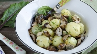 Young potatoes with mushrooms and dill.