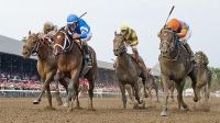 Golden Ticket, with jockey David Cohen aboard, and Alpha, ridden by Ramon Dominguez, finish in a dead heat for the win in the Travers Stakes at Saratoga Race Course on Travers Stakes Day in Saratoga Springs, New York on August 25, 2012.