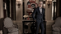 Hilfiger in front of a Jean-Michel Basquiat painting in his New York apartment. He wears clothing from the Tommy Hilfiger fall/winter 2013 collection.