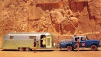 An Airstream passes by the bas-relief of Sapor I in Iran.