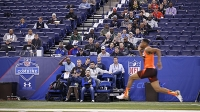 NFL team personnel watch quarterback Jameis Winston of Florida State run the 40-yard dash during the 2015 NFL Scouting Combine.