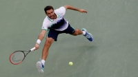 Marin Cilic returns a shot against Kei Nishikori during their men's singles final match of the 2014 U.S. Open.