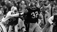 "Pittsburgh RB Franco Harris returns ""The Immaculate Reception"" for a TD in 1972."