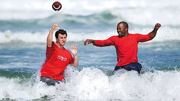 Manziel with Whitfield breaking the waves in San Diego.