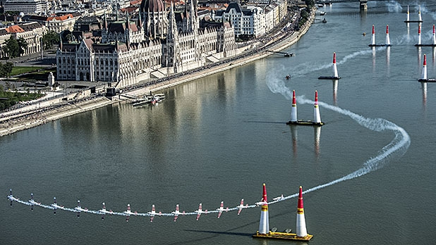 In a composite image, Paul Bonhomme of Great Britain performs during qualifying day of the fourth stage of the Red Bull Air Race World Championship in Budapest, Hungary on July 4, 2015.