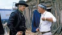 James Coburn and director Sam Peckinpah talk on the set of Pat Garrett and Billy the Kid, 1973.