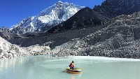 Scott Watson deploys temperature loggers in a lake developing on Mount Everest's Khumbu Glacier.