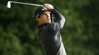 Thorbjorn Olesen of Denmark tees off on the 2nd hole during day one of the BMW PGA Championship at Wentworth on May 22, 2014 in Virginia Water, England.