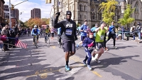 Former NBA center Jason Collins ran the NBA's New York City Marathon relay with a junior New York Road Runners ambassador.
