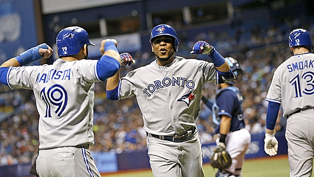 Edwin Encarnacion #10 of the Toronto Blue Jays celebrates his two-run home run with teammate Jose Bautista #19 during the sixth inning of a game against the Tampa Bay Rays on October 3, 2015 at Tropicana Field in St. Petersburg, Florida.