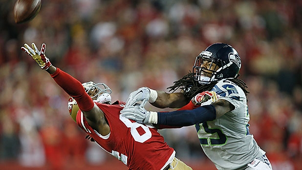 Richard Sherman #25 of the Seattle Seahawks covers Brandon Lloyd #84 of the San Francisco 49ers during an incomplete pass in the first quarter at Levi's Stadium on November 27, 2014 in Santa Clara, California.