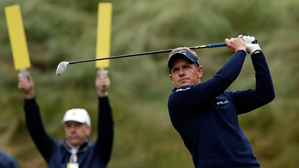Luke Donald, of England, tees off on the 18th hole during the first round of the U.S. Open golf tournament at Merion Golf Club, Friday, June 14, 2013, in Ardmore, Pa.