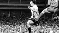 Manchester United's Joe Jordan is stopped with a kick in the groin by goalkeeper Ray Clemence of Liverpool in 1979.
