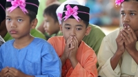 Boys pray during a ceremony before they are circumcised in Kajang outside Kuala Lumpur.