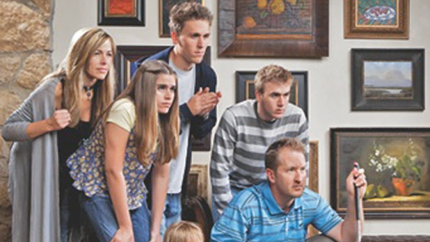 Duval in his Denver home with his wife, Susie, and four of their five children.