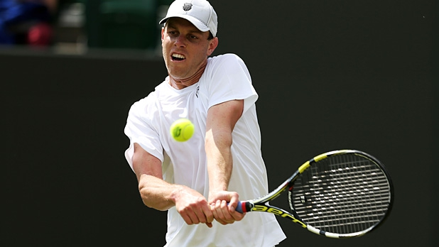 Sam Querry of United States of America plays a backhand during his Gentlemen's Singles first round match against Bernard Tomic of Australia on day two of the Wimbledon Lawn Tennis Championships on June 25, 2013 in London, England.