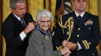 President George W. Bush presents the Presidential Medal of Freedom to Harper Lee, November 5, 2007 in the East Room of the White House.