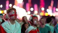 Fans watch the England vs Italy match at The Isle of Wight Festival at Seaclose Park on June 14, 2014 in Newport, Isle of Wight.