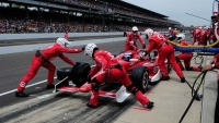 The Target Chip Ganassi Racing team at work in the pits.