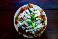 tag-burger-bar_green-chili-fries_photo-cred-tag-restaurant-group-30f6c62f-eb93-4aee-8308-14bcf085616c